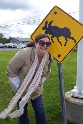 Kathryn Basham with Moose sign