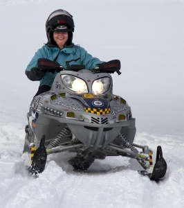 Kathryn Basham on a Snowmobile